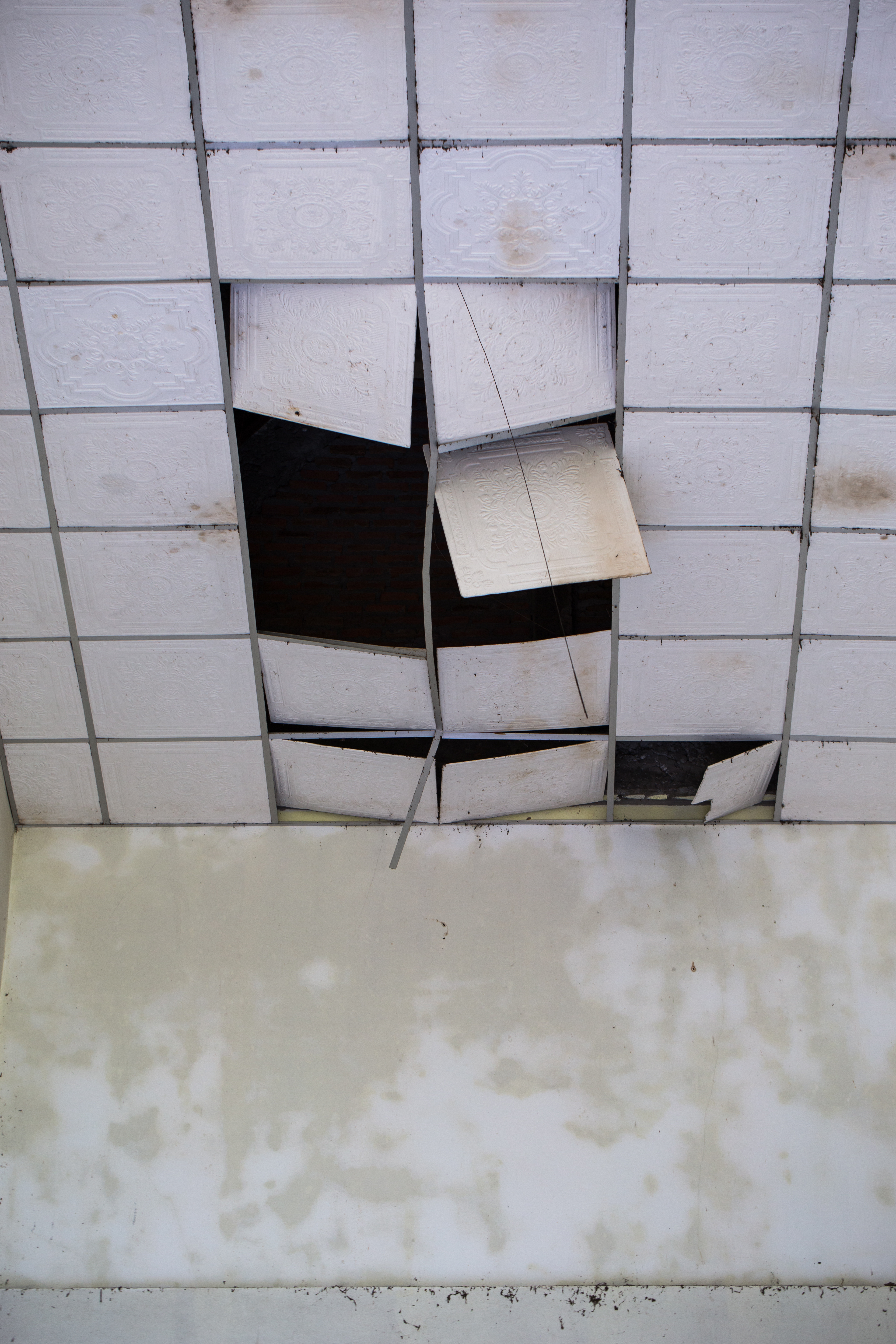 Home ceiling panels damaged by storm winds